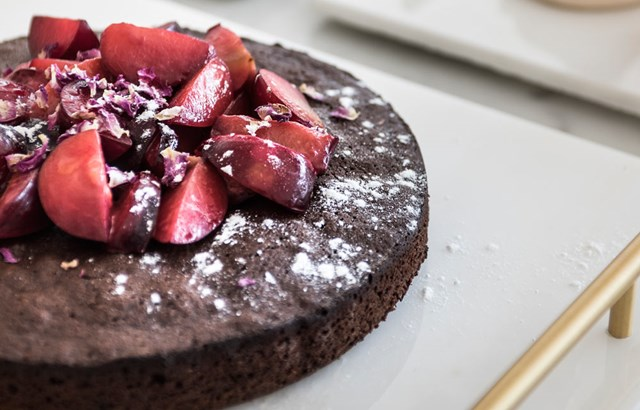 Chocolate cake with stewed plums