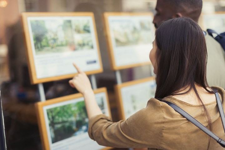 Woman looking at property adverts