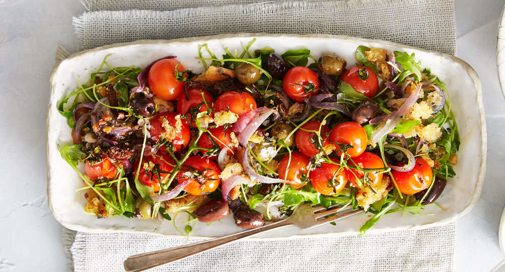 Warm roasted olive, tomato and rocket salad with toasted ...