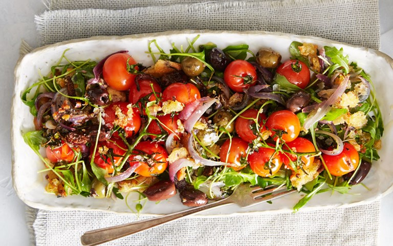 Warm roasted olive, tomato and rocket salad with toasted ciabatta crumble