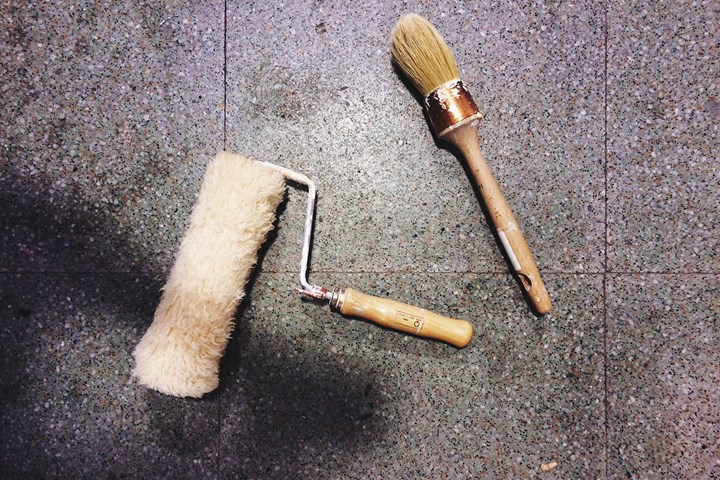 paint roller and brush on tiles