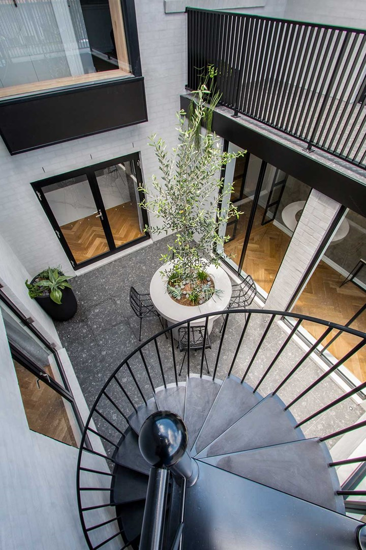 Black spiral staircase in courtyard