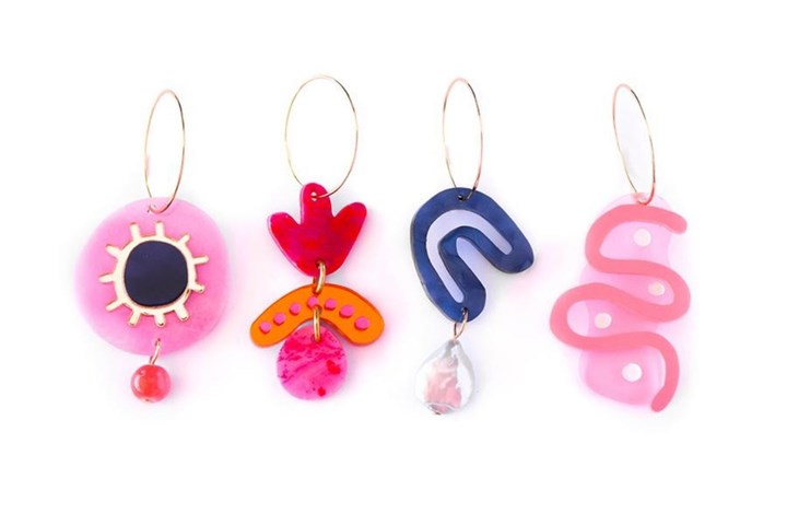 four bright earrings lined up
