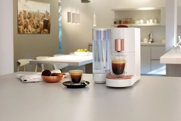 K-Fee coffee machine on a grey benchtop