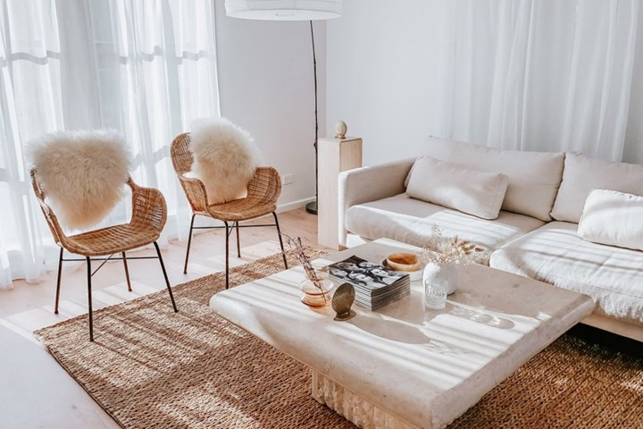 Coastal living room with two wicker occasional chairs