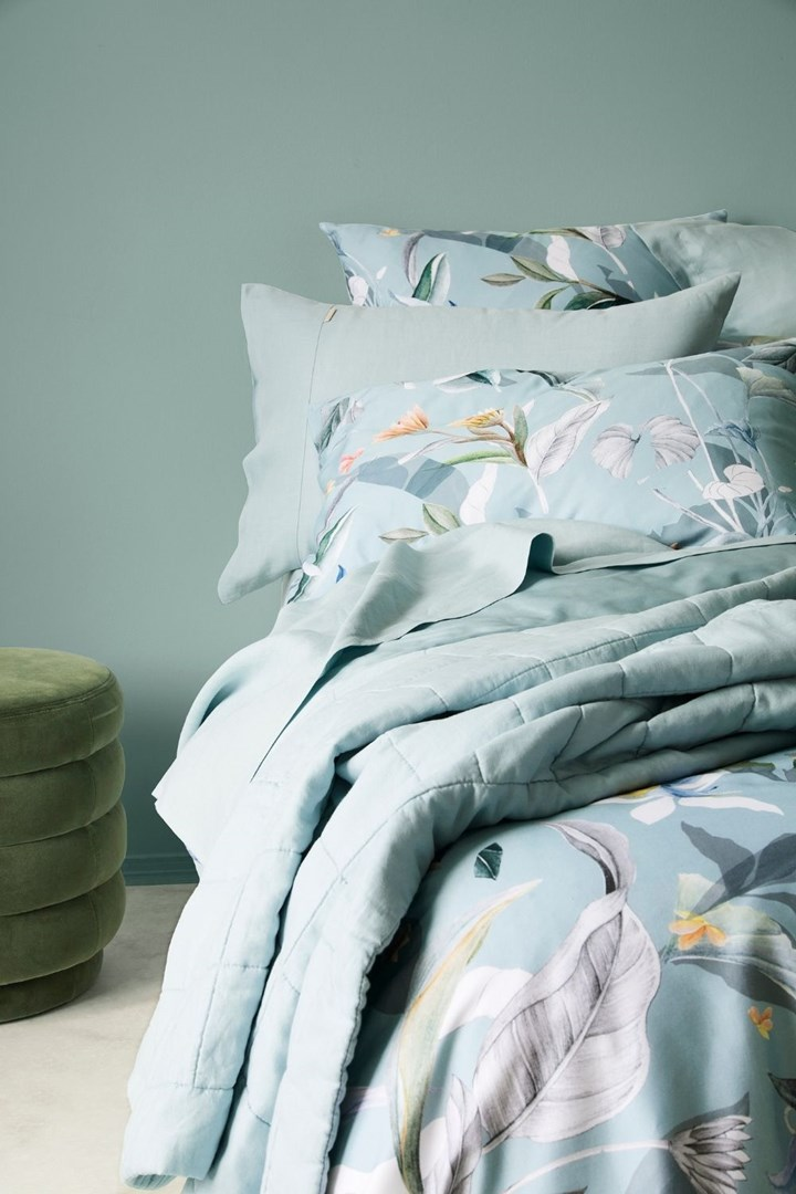 Bed made up with floral green bedding from Sheridan