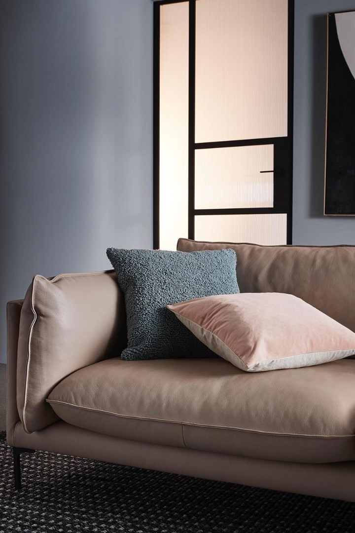 Freedom sofa with two throw cushions