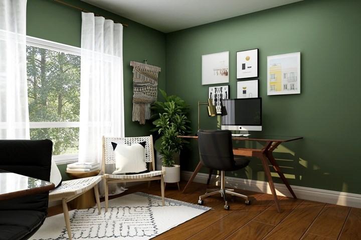 Bureau à domicile avec murs verts et bureau en bois