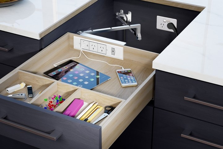 Docker drawer for charging electronic devices