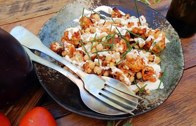 Roasted cauliflower bites with chickpeas, pine nuts and sour cream dressing