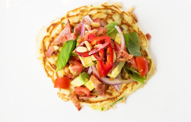 Savoury zucchini pancakes topped with bacon, basil and balsamic vinegar